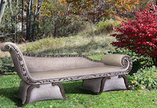 life-sized outdoor granite sculpture of a grecian sofa