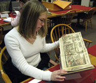 student examines collections