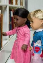 American Girl dolls in stacks